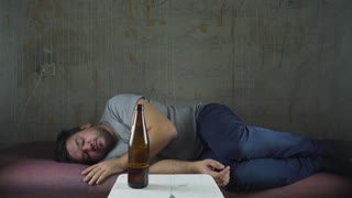 Drunk Man Sleeping, from top, pan shot.