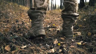 men's shoes in autumn a man tied a lacing on boots in the woods