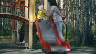 Mom and child playing on the playground