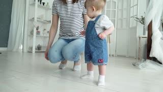 Mom Teaches a Child to Walk
