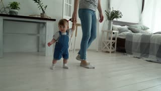 Mom Teaches a Child to Walk