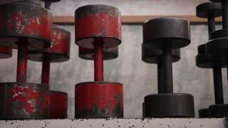 Old dumbbells in workout gym.