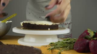 Pouring frosting on Cake. Making Chocolate Layer Cake. Series.