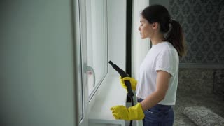 Professional cleaning of Windows. Window washing with special detergent . a housewife or cleaning lady