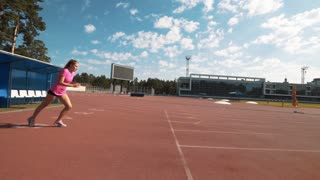 Professional female hurdler during training