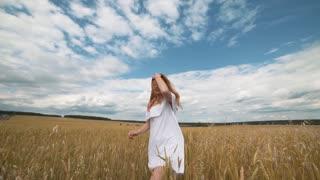 Redhead girl at wheat field
