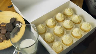 Set of different delicious cupcakes in a paper box