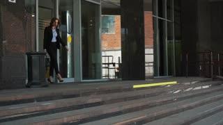 Smart city business woman walking near the huge business centre