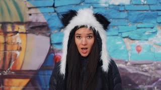 studio portrait of brunette girl in hat panda