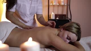 The concept of massage. Beautiful young woman receiving health, therapeutic massage