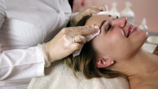 Woman getting rf lifting in her face in clinic. Anti-aging RF-therapy, rejuvenation and lifting procedure.