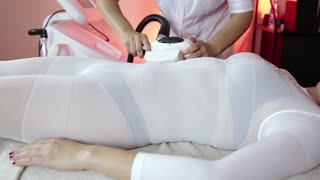 Woman lying down for LPG massage treatment