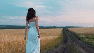 Woman taking walk on rural road