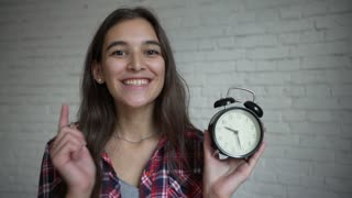 Young girl holding vintage clock