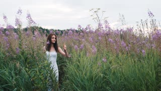 Young pretty girl walking in lavender field.