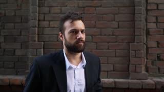 Young Sad Man Looking Camera Presentation Posing Serious Look Red Bricks Wall