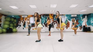 Women group training in aerobic class on a fitness center. Sport and health concept.