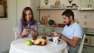 Young couple having dinner at home. Modern dating.