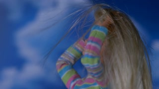 GIRL DOLL GLAMOUR SHOT.  SLOW MOTION WIND IN HAIR.  IN 4K.