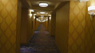 HOTEL HALLWAY POV SHOT.  UPSCALE LUXURY HOTEL.