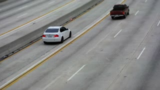 LOS ANGELES FREEWAY.  ALL LANES IN TIME LAPSE, TILT SHIFT.
