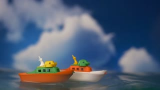TOY BOATS RIDE THE BIG WAVES.  IN 4K.