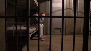 MAN PACING IN A JAIL CELL, MODEL RELEASE