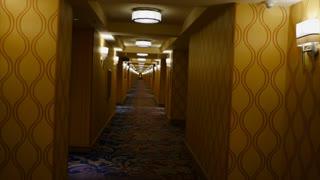 POV WALKING DOWN UPSCALE HOTEL CORRIDOR