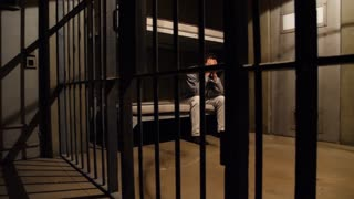 REMORSEFUL MAN IN HIS JAIL CELL, MODEL RELEASE