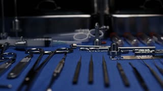 SURGICAL TOOLS READY TO GO TO WORK.  LOW ANGLE DOLLY MOVE ACROSS NEATLY ARRANGED SURGICAL TOOLS.  SHOT IN 4K, 10 BIT, APPLE PRO RES 422.