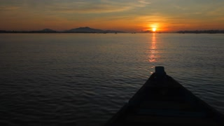 BOAT POV WS Boat Going out to Sea at Sunset / Vietnam
