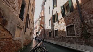 BOAT POV WS Gondola Floating down Narrow Canal / Venice, Italy