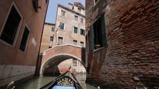 BOAT POV WS Gondola Floating down Narrow Canal / Venice, Italy