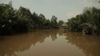 BOAT POV WS Mekong River with Stilt Houses / Vietnam