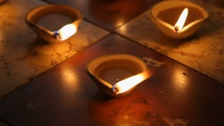 CU Burning clay oil lamps on tiled floor / Singapore