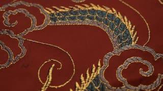 CU DS Embroidered silk dragon on red cloth
