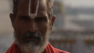 CU Elderly man looking at camera / India