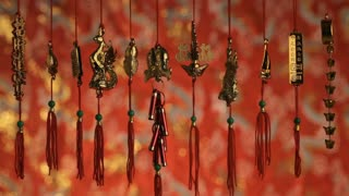 CU Gold Chinese decorations hanging from red strings