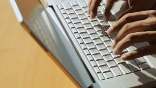 CU HA PAN Person typing on laptop keyboard, view of hands