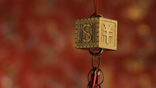 CU Hanging decoration depicting Yen and Dollar signs
