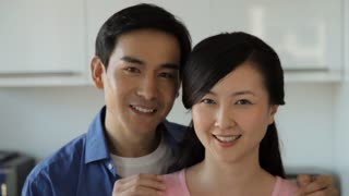 CU Head shot of couple looking at each other and smiling / China