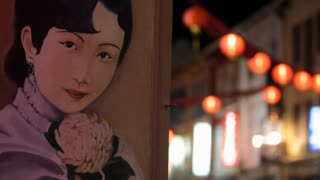 CU Painted mural of Chinese woman with lanterns in background / Singapore