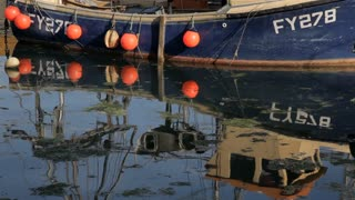 CU Reflection of Fishing Boat in Water / Cornwall, England, UK