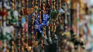 CU SELECTIVE FOCUS Decorations hanging on market stall / Singapore