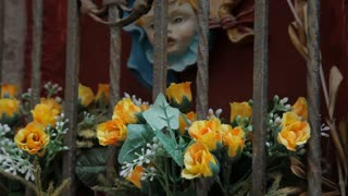 CU TU Flowers in Shrine of Virgin Mary and Baby Jesus / Venice, Italy