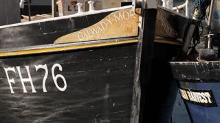 CU Water Reflecting on Boat's Hull / Cornwall, England, UK