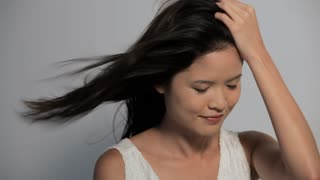 CU Woman looking at camera with hair blowing in wind