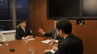 DS MS Senior businessman talking to young business people in boardroom / China