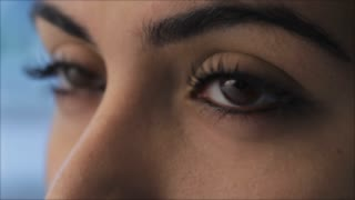 ECU Woman blinking, view of eyes