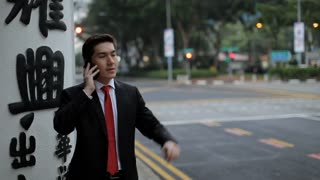 MH Businessman Standing on Street Talking on Phone / Singapore